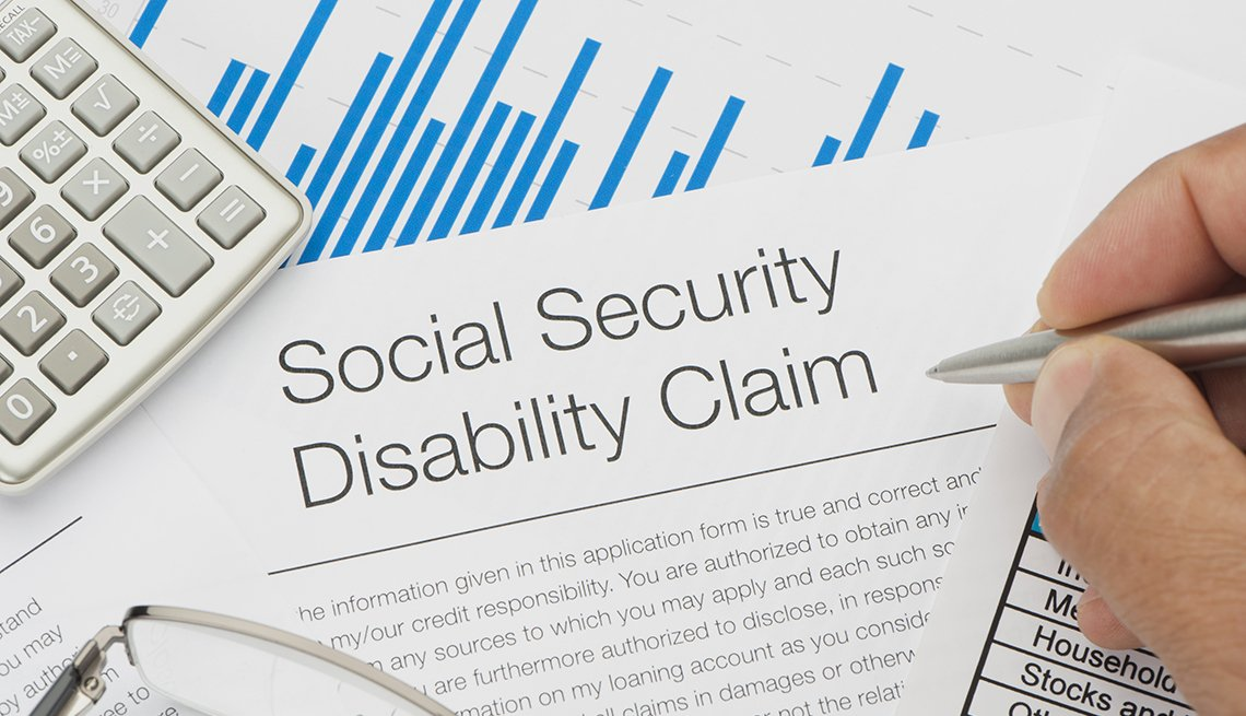 Close up of Social Security Disability Claim Form with writing hand
