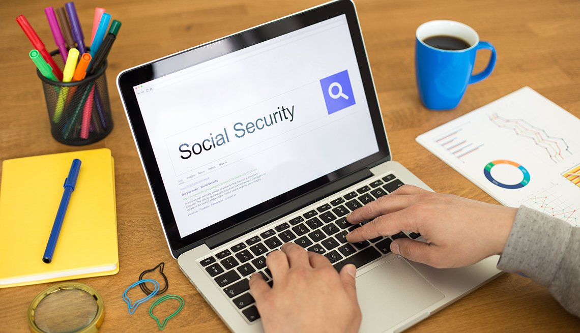 hands on laptop keyboard searching Social Security on internet search browser