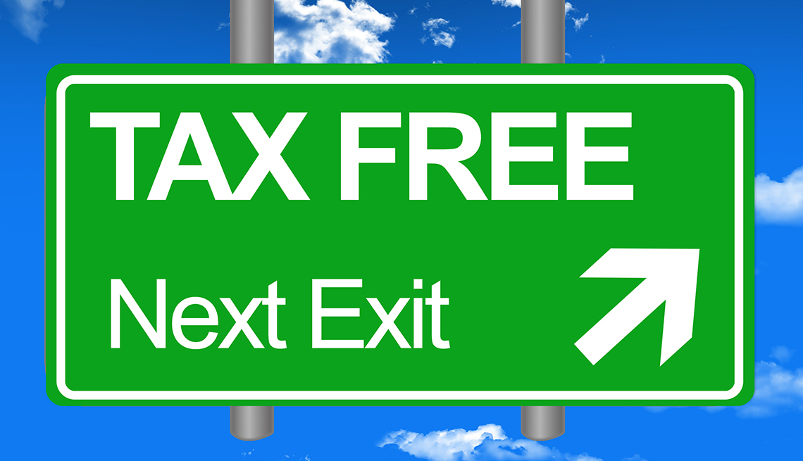 illustrated road sign says Tax Free, Next Exit and has an arrow pointing the way
