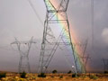 Rainbow over electrical towers