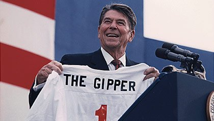 President Ronald Reagan accepts a shirt commemorating his most famous film role
