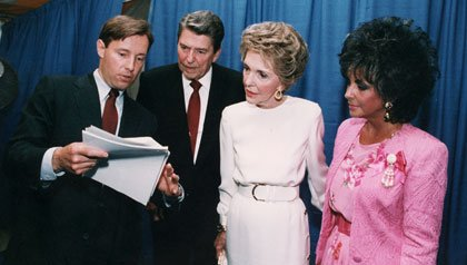 Elizabeth Taylor and the Reagans prepare for a speech about AIDS research