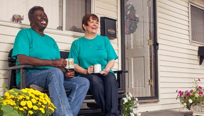 Annie Hardison (l) and Jan Kirk Wright (r) sit on Annie's porch enjoying a cup of coffee before the annual People Helping People Together work day in Columbia, TN - Volunteering