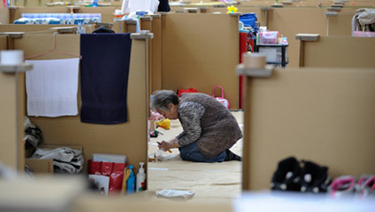 woman preparing lunch at tsunami shelter in Mikayo after the 2011 Japanese Tsunami