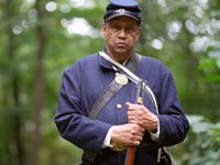 Mel Reid is an African American civil war reenactor with the Massachusetts 54th Company B.