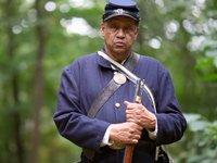 Mel Reid is an African American civil war reenactor with the Massachusetts 54th Company B.