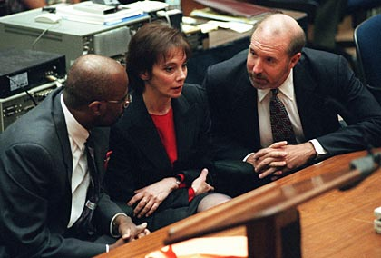 Prosecutors Christopher Darden, Marcia Clark and William Hodgman confer after Simpson is acquitted of murder, 1995