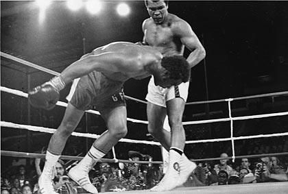 Muhammad Ali knocks out George Foreman.