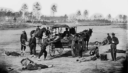 An ambulance crew demonstrating removal of wounded soldiers from the field during the Civil War.