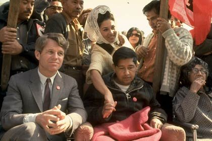 Robert F. Kennedy sits next to César Chávez (looking very weak after a prolonged hunger strike) during a rally in support of the United Farm Workers union in 1968.