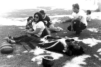 Helen Chávez gives her husband César Chávez a foot rub during a break in the 1,000 Mile March through California during the summer of 1975. The march was a 59 day trek organized by the UFW, from the Mexican border at San Ysidro to Salinas and then from Sacramento south down the Central Valley to the UFW's La Paz headquarters at Keene, southeast of Bakersfield.