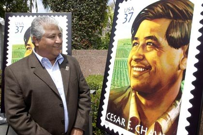 "Paul Chávez, the son of civil rights and farm labor leader César E. Chávez, looks at a replica of the stamp the U.S. Postal Service unveiled in Los Angeles on Wednesday, April 23, 2003, the 10th anniversary of Chávez's passing. ""It is a proud moment for the Postal Service to pay tribute to this great man who stands as a true American hero,"" said Benjamin Ocasio, vice president of diversity, U.S. Postal Service."