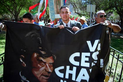 Ricardo Chávez, 26, the nephew of César Chávez, holds a banner with the picture of César Chávez as he leads a procession in El Paso, Texas, on March 31, 2000, in celebration of the birth date of the civil rights leader.