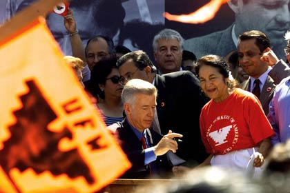 California Gov. Gray Davis, center, signs into law Senate Bill 984 that creates a new California state holiday honoring United Farm Workers (UFW) founder César E. Chávez, on August 18, 2000. The bill's author, Sen. Richard G. Polanco, D-Los Angeles, is partially seen behind Davis. At right, Dolores Huerta, co-founder of the UFW.
