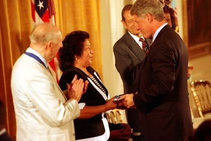 Helen Chávez, widow of César Chávez, accepts the Presidential Medal of Freedom— awarded posthumously to the labor leader—from President Bill Clinton during a White House ceremony in Washington, D.C. on August 8, 1994.