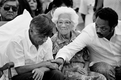 UFW president César Chávez, his mother Juana Estrada Chávez, and the Rev. Jesse Jackson at the Mass during which Chávez ended his 36-day Fast for Life, in 1988. Jackson, in solidarity, embarked on his own three-day fast on that day.