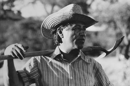 César Chávez, founder of the United Farm Workers (UFW), takes a break during work on the community garden at UFW headquarters in La Paz, California, in 1975.