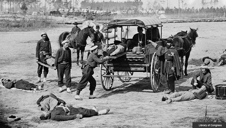 ambulance crew demonstrating removal of wounded soldiers from the field during the Civil War