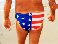 A man wears a bathing suit made from the America Flag design.
