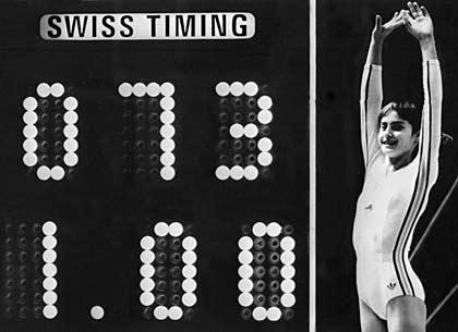 Gymnast Nadia Comaneci scores perfect 10 at 1976 Summer Olympics