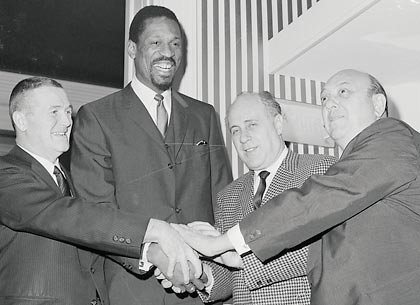 Bill Russell, second from left, after being named coach of the Boston Celtics in 1966.