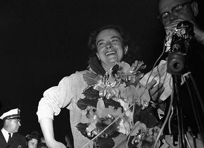 Jerrie Mock celebrates her flight around the world on April 17, 1964.