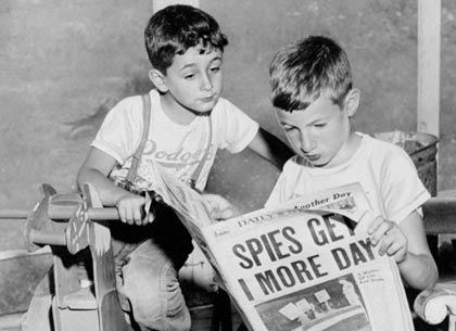 boys reading paper