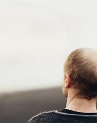 man looking to the horizon