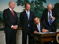 President Barack Obama signs an executive order creating the bipartisan National Commission on Fiscal Responsibility and Reform.
