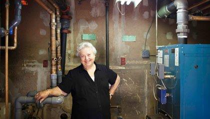 Frieda Denenmark with boiler, has hopes for Connecticut's new energy program.
