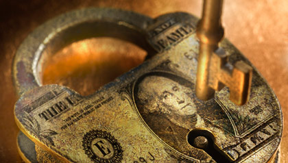 Lock with dollar bill on it- the national debt