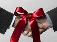 Hands shaking with red bow - Congressional budget deal analysis