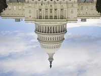 Capitol building upside down – Medicare and Medicaid spending along with Social Security checks are threatened in stalled debt talks.