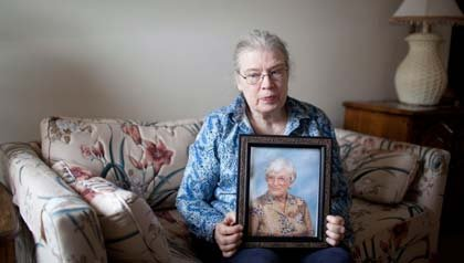 AARP Minnesota voter ID law woman with picture of mother