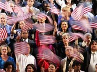 Group of people waiving American Flags, What issues matter to older voters in the 2012 Presidential Election