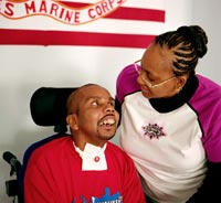 Marine Sergeant Shurvon Phillip was injured in Al Anbar, Iraq and is now cared for by his mother Gail Ulerie.