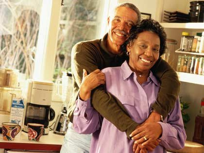 mature couple standing in kitchen