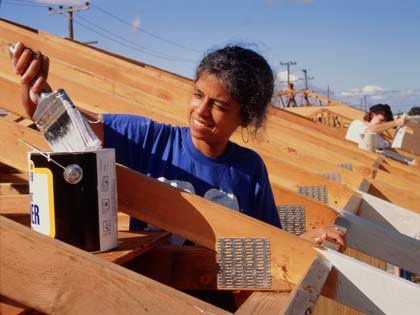 woman doing volunteer painting for 'Habitats for Humanity'