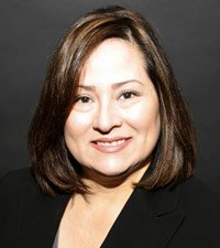 Portrait of AARP Colorado Associate State Director of Communications Angela Cortez.