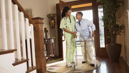 Nursing at home with woman with walker