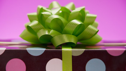 AARP Iowa State Office Giveaway Gift- a box with a green bow