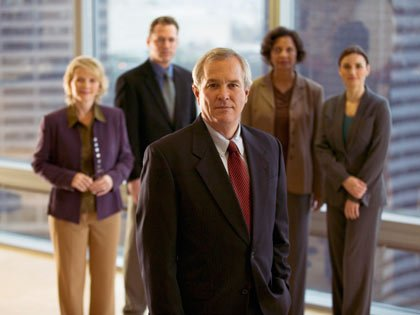 businesspeople in front of window