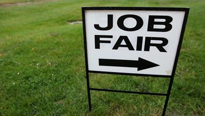 Job fair sign in the grass