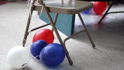 Balloons sit on the floor