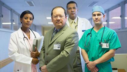 Male and female hospital medical staff members, portrait
