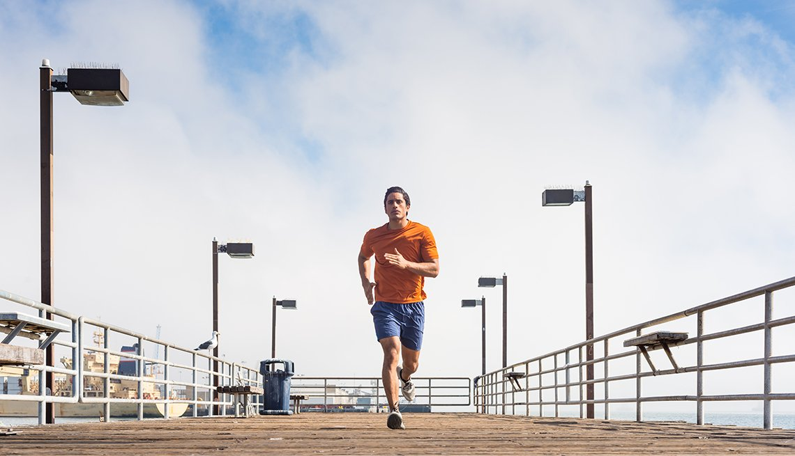 man running on a ocean pier