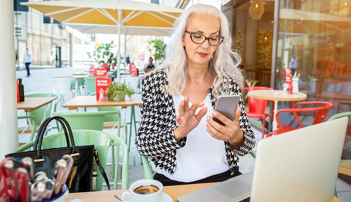 Mature woman texting on phone