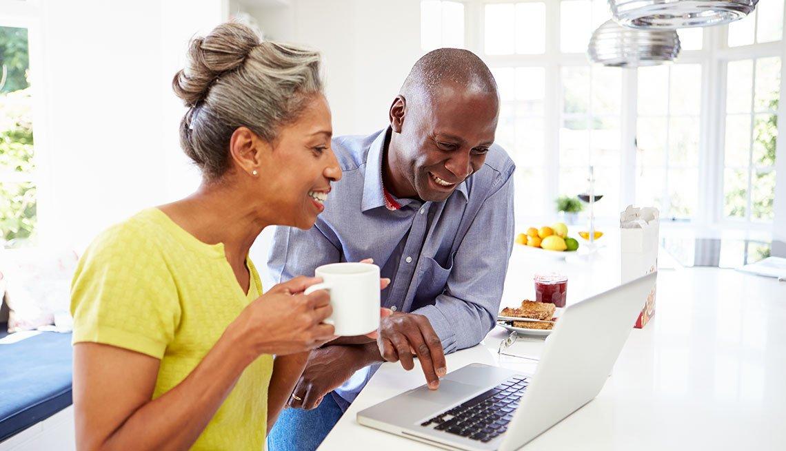 Mature couple using a laptop