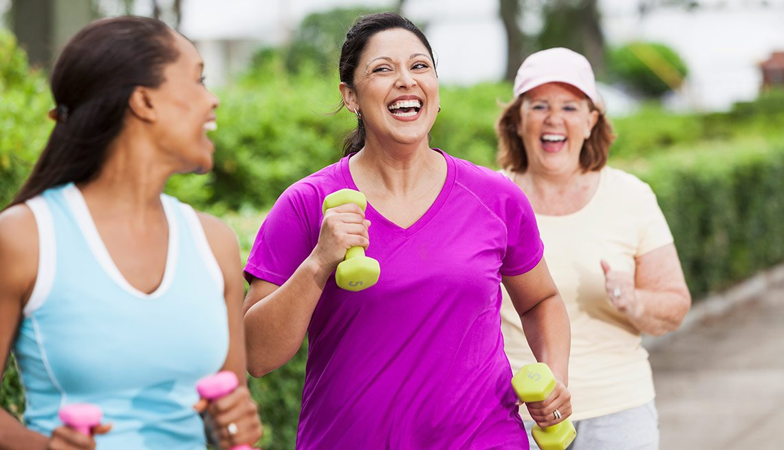 Multi-ethnic women exercising in park, power walking.