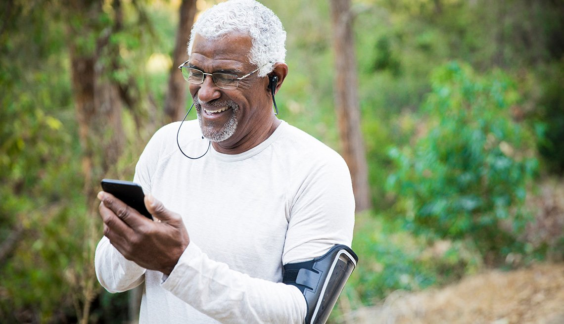 Senior man checking smartphone